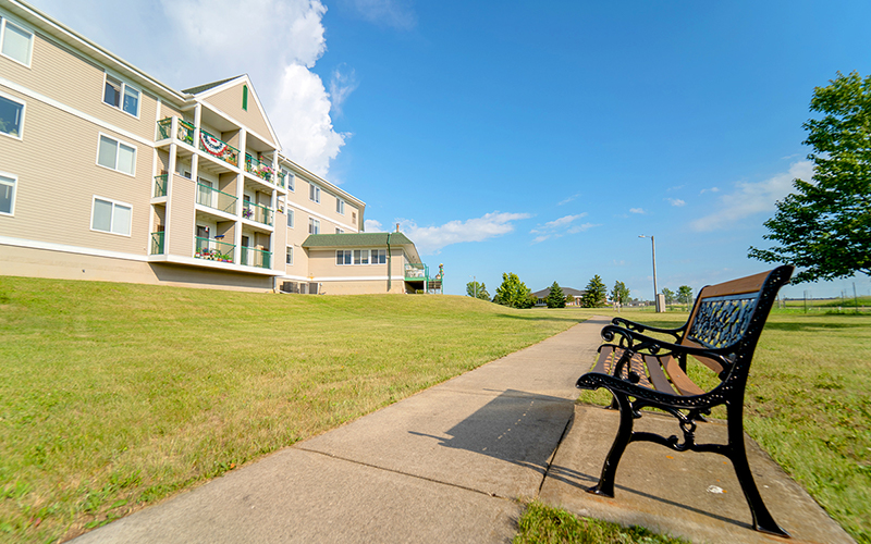 Northview Manor walkway with meta bench